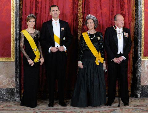 Textile, Formal wear, Suit, Coat, Curtain, Tie, Blazer, Costume accessory, Costume, Monarch,