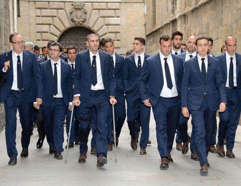 Clothing, Footwear, Coat, Trousers, Collar, Dress shirt, Suit trousers, Suit, Shirt, Standing,
