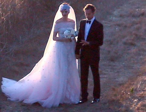 Trousers, Coat, Photograph, Dress, Outerwear, Bridal clothing, Wedding dress, Suit, Bride, Formal wear,