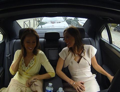 Smile, Shoulder, Dress, Vehicle door, White, Car seat, Happy, Water bottle, Facial expression, Fashion accessory,