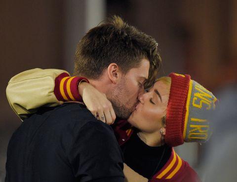 Ear, Yellow, Interaction, Sharing, Love, Kiss, Romance, Hug, Folk instrument, Caesar cut,