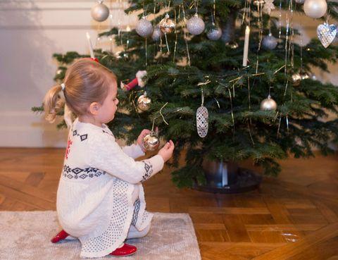 Floor, Christmas decoration, Flooring, Christmas ornament, Interior design, Holiday, Christmas tree, Christmas eve, Holiday ornament, Baby & toddler clothing,