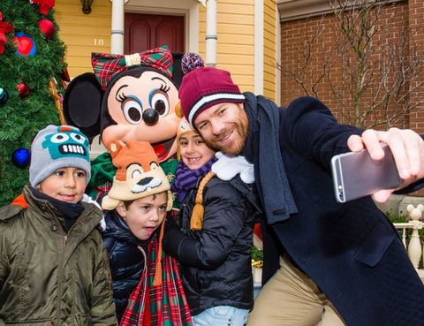 Winter, Jacket, Holiday, Glove, Tartan, Plaid, Mascot, Christmas decoration, Holiday ornament, Fur,