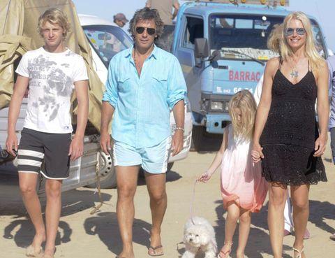 Dress, Dog breed, Shorts, Dog, Toy dog, Carnivore, Sunglasses, Maltepoo, Blond, Bermuda shorts,