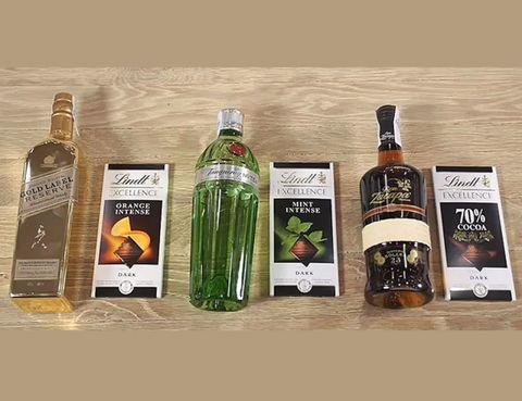 Liquid, Glass bottle, Bottle, Drink, Fluid, Alcohol, Alcoholic beverage, Distilled beverage, Drinkware, Logo,