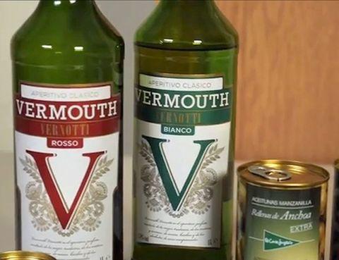 Green, Bottle, Glass bottle, Alcohol, Drink, Alcoholic beverage, Glass, Logo, Distilled beverage, Drinkware,