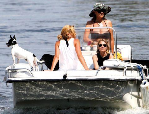 Eyewear, Vision care, Dog, Watercraft, Carnivore, Boat, Goggles, Hat, Sunglasses, Vacation,