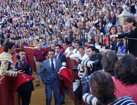 Crowd, People, Audience, Mammal, Fan, Convention, Public event, Bullring, Stadium, Matador,