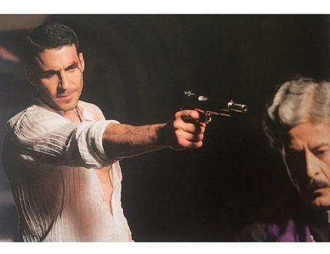 Elbow, Shooting, Revolver, Air gun, Gun barrel, Precision sports, Individual sports, Gunshot, Wrinkle, Gadget,