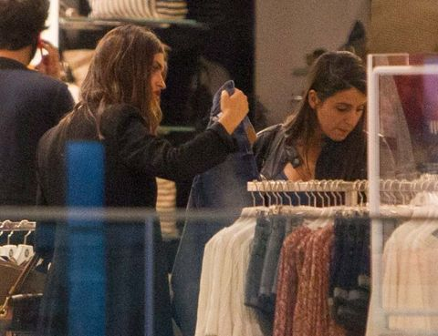 Hair, Textile, Clothes hanger, Fashion, Long hair, Brown hair, Retail, Boutique, Fashion design, Makeover,