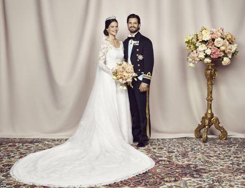 Clothing, Trousers, Bridal clothing, Dress, Photograph, Petal, Coat, Bouquet, Wedding dress, Gown,