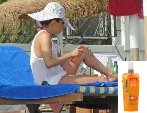 Hat, Liquid, Bottle, Summer, Sitting, Outdoor furniture, Vacation, Curtain, Straw, Sun hat,