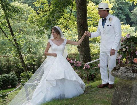 Clothing, Hat, Trousers, Dress, Shirt, Coat, Photograph, Wedding dress, Petal, Bridal clothing,