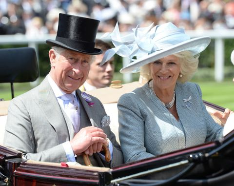 Clothing, Hat, Coat, Outerwear, Fashion accessory, Suit, Facial expression, Formal wear, Sun hat, Headgear,