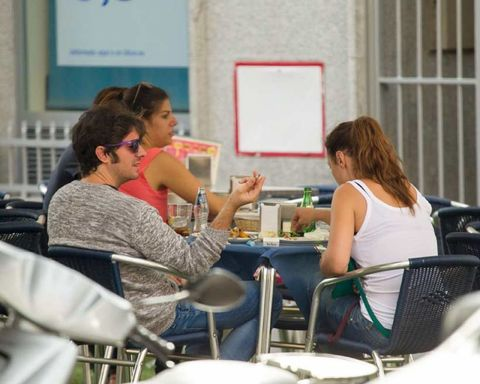 Furniture, Chair, Table, Sitting, Sharing, Conversation, Outdoor furniture, Outdoor table, Whiteboard, Customer,