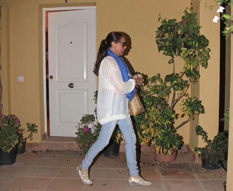Trousers, Shirt, Door, Outerwear, Flowerpot, Jacket, Street fashion, Bag, Home door, Houseplant,