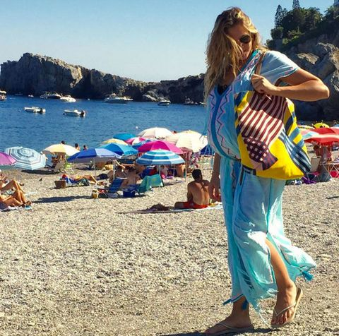 Coastal and oceanic landforms, Tourism, Summer, People in nature, Coast, Watercraft, Umbrella, Shore, Musical instrument, Travel,