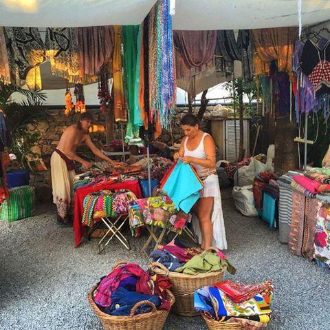 Textile, Public space, Basket, Storage basket, Market, Human settlement, Home accessories, Curtain, Wicker, Selling,