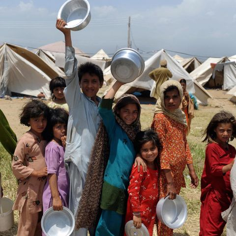 Smile, People, Community, Tent, Sharing, Wind instrument, Tradition, Helicon, Sousaphone, Dishware,