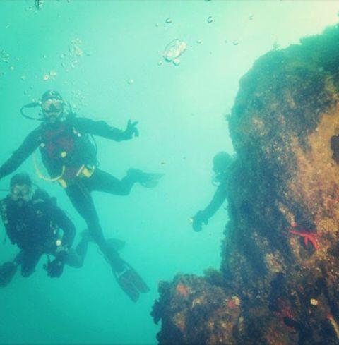 Underwater, Fluid, Human, Organism, Underwater diving, Fun, Diving equipment, Recreation, Personal protective equipment, Scuba diving,