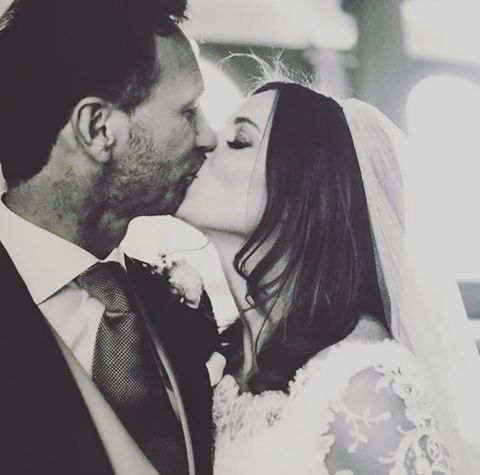 Clothing, Forehead, Photograph, Outerwear, Happy, Coat, Bridal clothing, Kiss, Formal wear, Style,