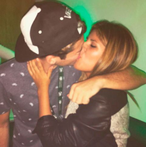 Kiss, Cap, Interaction, Romance, Love, Jacket, Leather jacket, Gesture, Leather, Baseball cap,