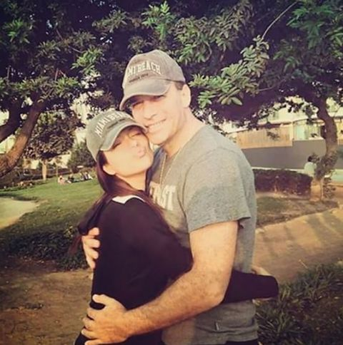 Cap, Photograph, T-shirt, Hat, Baseball cap, Interaction, Love, Gesture, Cricket cap, Romance,