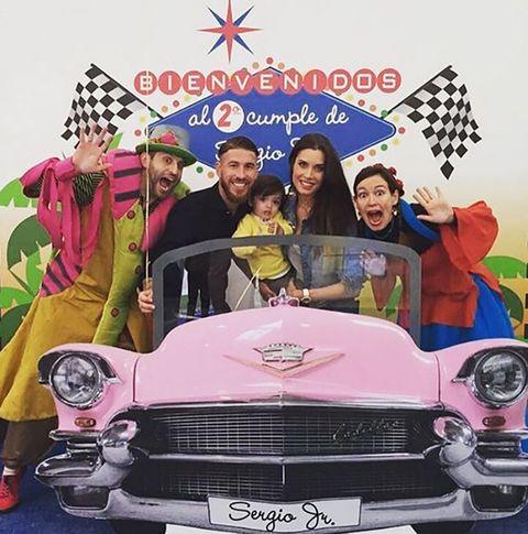 Vehicle, Automotive design, Classic car, Car, Pink, Hat, Automotive exterior, Grille, Classic, Antique car,