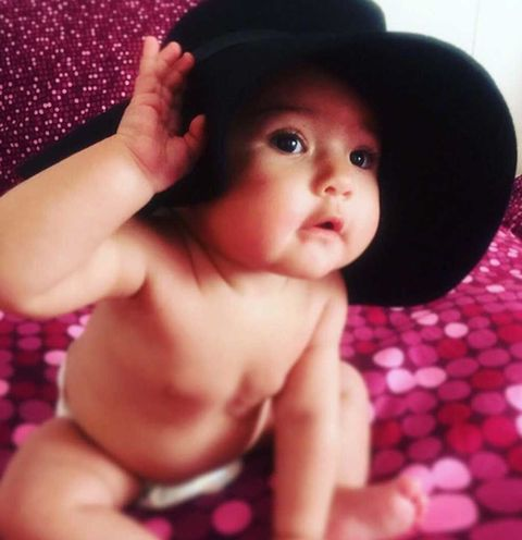 Lip, Cheek, Skin, Hat, Child, Pink, Barechested, Black hair, Organ, Costume accessory,