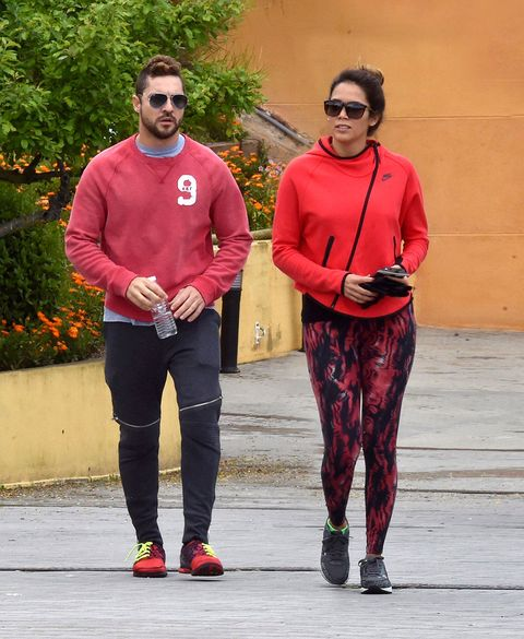 Clothing, Eyewear, Sleeve, Trousers, Red, Textile, Outerwear, Standing, Sunglasses, T-shirt,