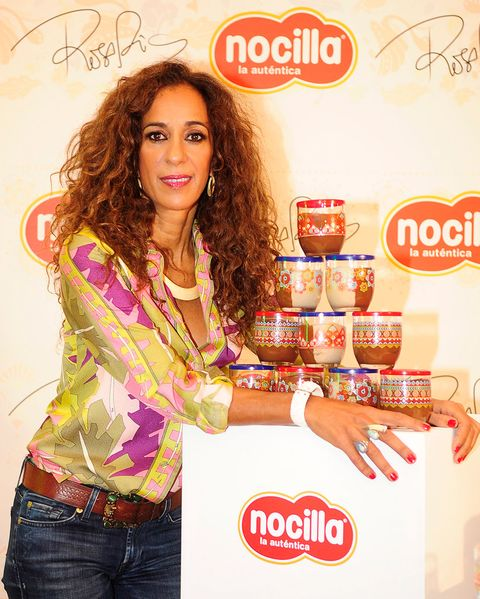 Denim, Jeans, Logo, Advertising, Jewellery, Long hair, Trunk, Poster, Brown hair, Abdomen,