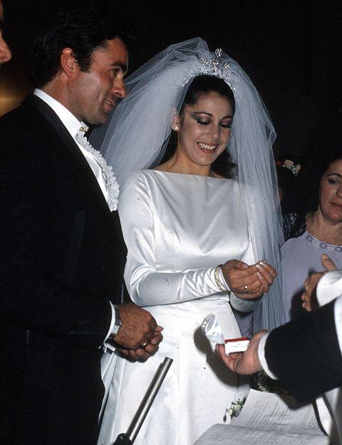 Bridal veil, Veil, Bridal clothing, Coat, Outerwear, Formal wear, Happy, Suit, Tradition, Dress,