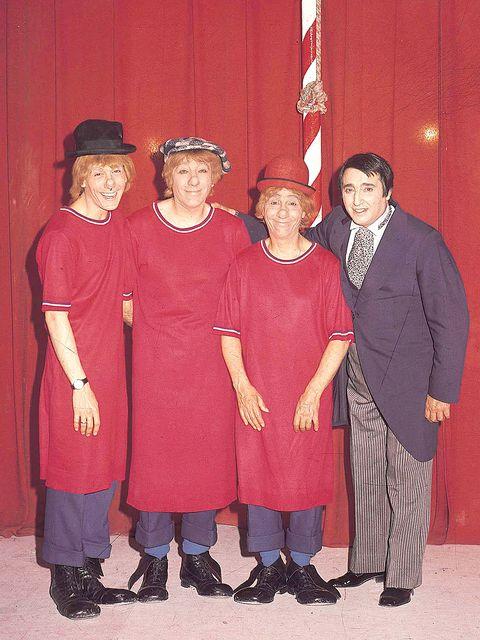 Footwear, Flag, Red, Hat, Headgear, Costume accessory, Vintage clothing, Maroon, One-piece garment, Sun hat,