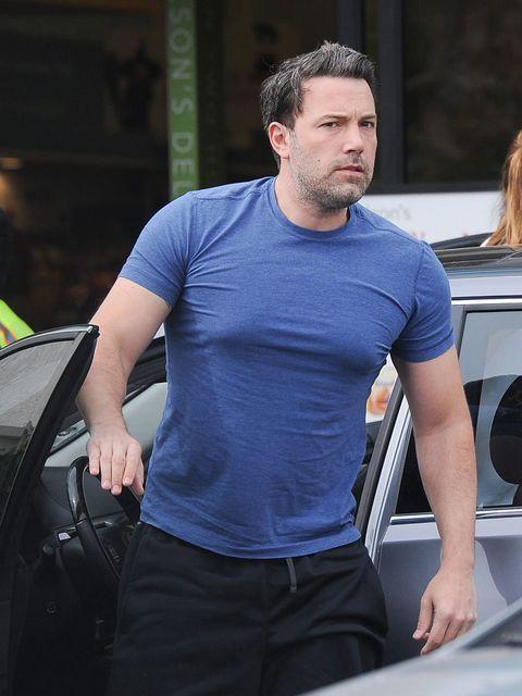 Shoulder, Facial hair, Muscle, Beard, Automotive window part, Windshield, Vehicle door, Hood, Active shirt, Belt,