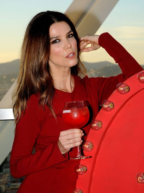 Arm, Lip, Hairstyle, Hand, Red, Wine glass, Drink, Stemware, Long hair, Lipstick,