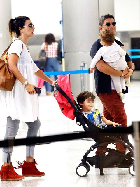 Footwear, Arm, Leg, Product, Trousers, Bag, Baby carriage, Luggage and bags, Baby Products, Street fashion,