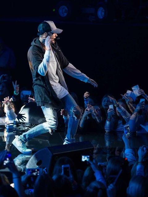 Cap, Entertainment, Hat, Music artist, Artist, Performance, Stage, Pop music, Baseball cap, Public event,