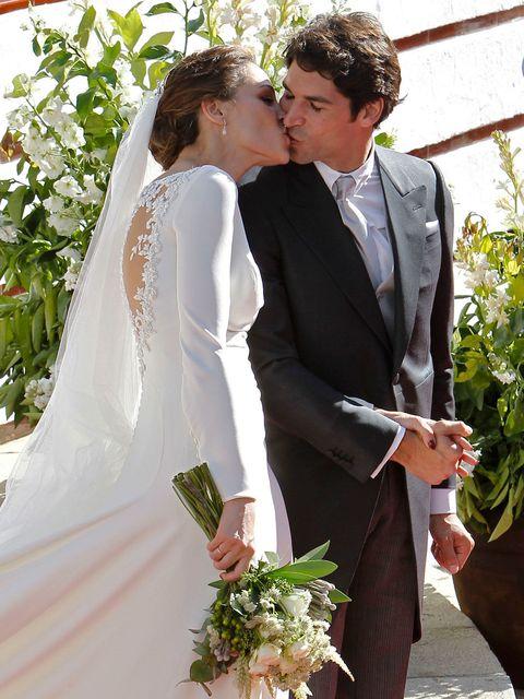 Clothing, Coat, Trousers, Bridal veil, Bridal clothing, Petal, Dress, Photograph, Suit, Outerwear,