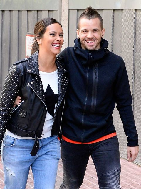 Smile, Sleeve, Trousers, Denim, Jeans, Textile, Outerwear, Happy, Jacket, Facial expression,