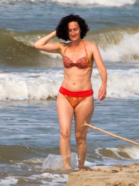 Clothing, Body of water, Fun, Hairstyle, Skin, Brassiere, Swimwear, Photograph, Human leg, Swimsuit top,