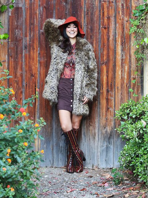 Clothing, Textile, Outerwear, Boot, Street fashion, Hat, Fashion accessory, Knee, Costume accessory, Dress,