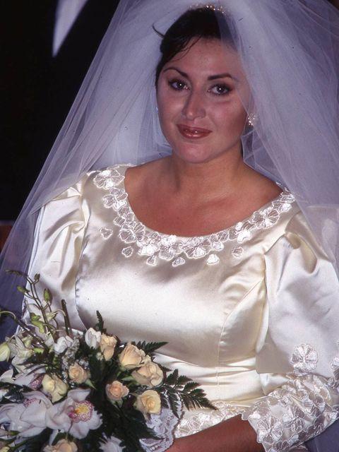 Clothing, Bridal veil, Bridal clothing, Veil, Eye, Bridal accessory, Shoulder, Dress, Photograph, Bouquet,
