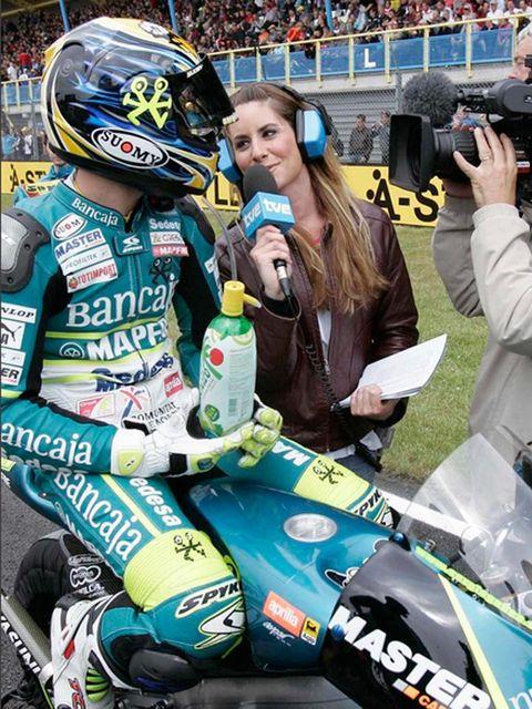 Camera, Digital camera, Video camera, Motorcycle helmet, Personal protective equipment, Logo, Helmet, Racing, Jersey, Championship,