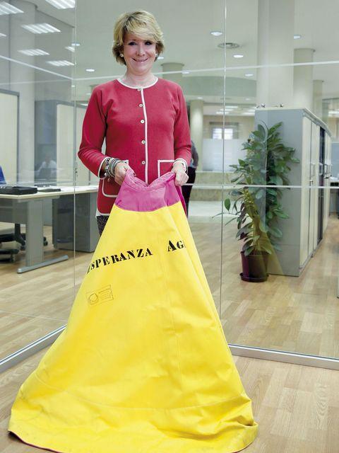 Yellow, Sleeve, Textile, Floor, Flooring, Interior design, Fashion, Gown, Waist, Jewellery,