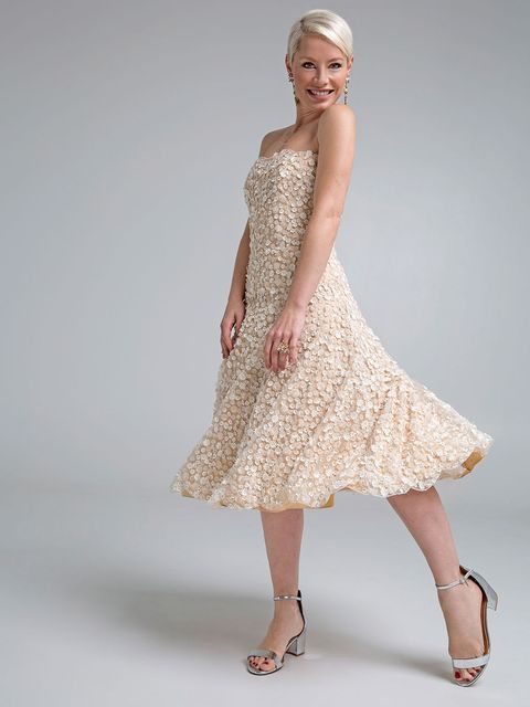 Sleeve, Shoulder, Human leg, Textile, Dress, Joint, White, One-piece garment, Style, Fashion accessory,