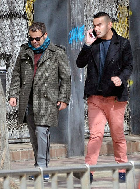 Clothing, Coat, Trousers, Shirt, Standing, Collar, Outerwear, Dress shirt, Style, Sunglasses,
