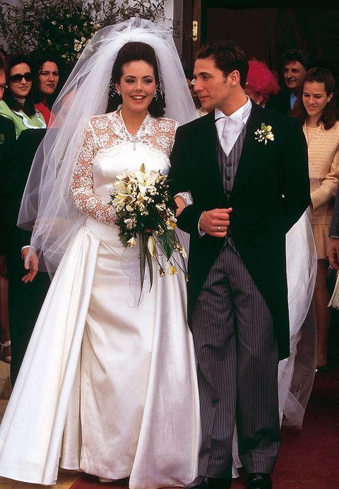 Clothing, Dress, Coat, Event, Bridal veil, Trousers, Bridal clothing, Shoe, Veil, Photograph,