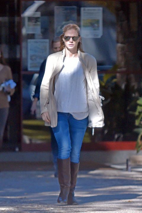 Clothing, Leg, Sleeve, Human body, Textile, Joint, Sunglasses, Outerwear, White, Boot,