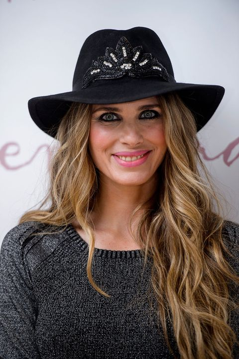 Clothing, Hat, Lip, Smile, Mouth, Brown, Hairstyle, Sleeve, Chin, Fashion accessory,