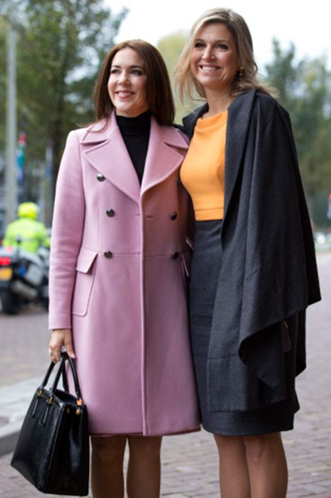 Clothing, Sleeve, Collar, Textile, Coat, Outerwear, Bag, Facial expression, Style, Street fashion,